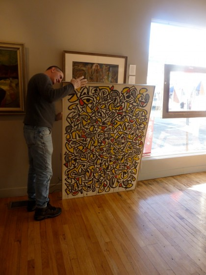 Adam Tamsky pulls out a Haynes painting
