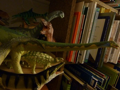 dinos on a shelf