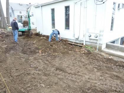 digging trench along house