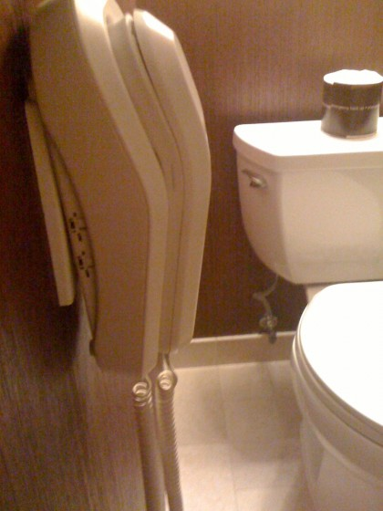 phone next to the toilet at the Wynn