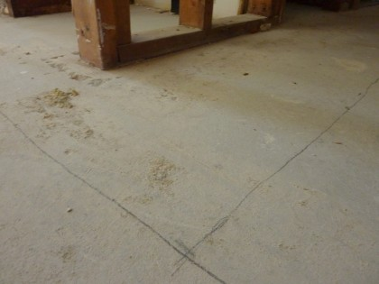 concrete floor marked out for cutting