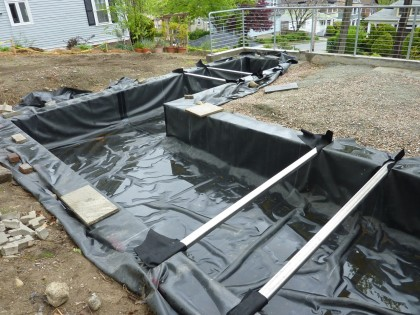pond liner — finished and rained on