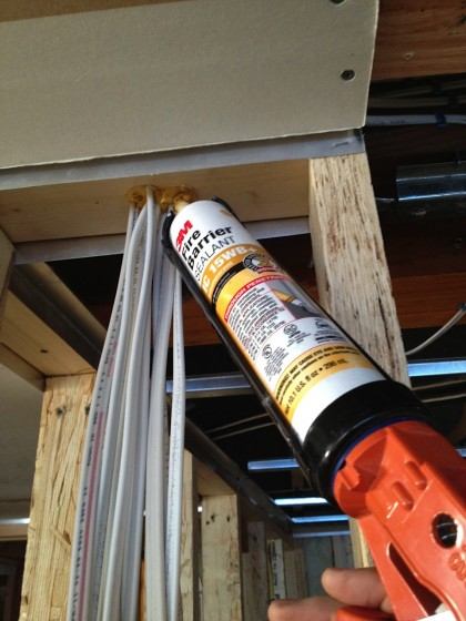 fire-rated caulk seals up the penetrations