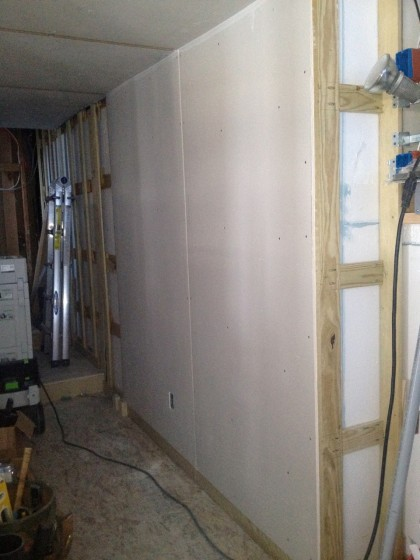 the first sheetrock goes up in the hallway
