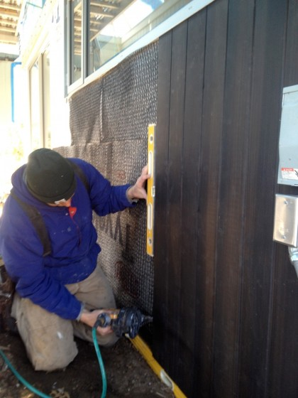 joe nails up the siding
