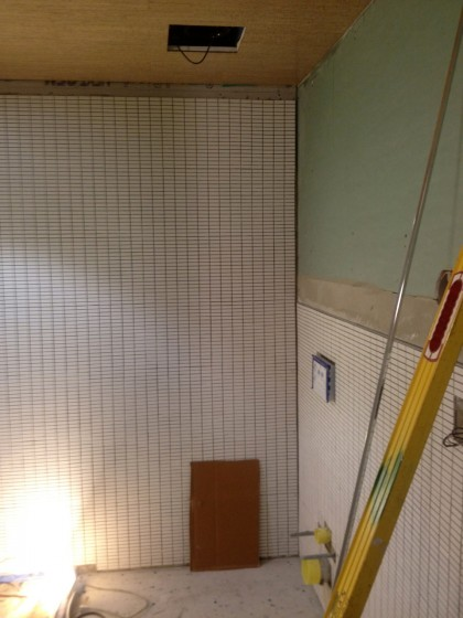 bath is tiled almost all the way to the ceiling now