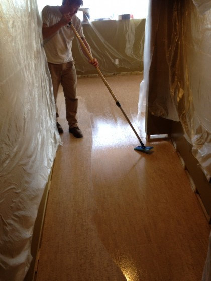 Joe adds a finish coat to the hallway into the downstairs