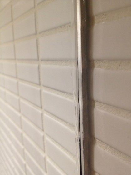 shower glass wall siliconed to the tile