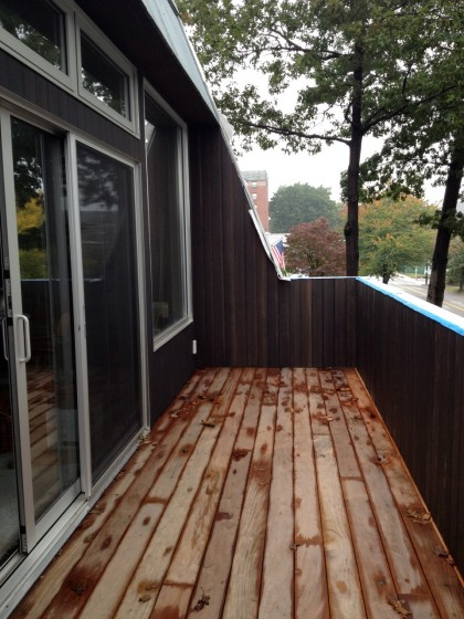 newly stained siding on the wing wall and railing